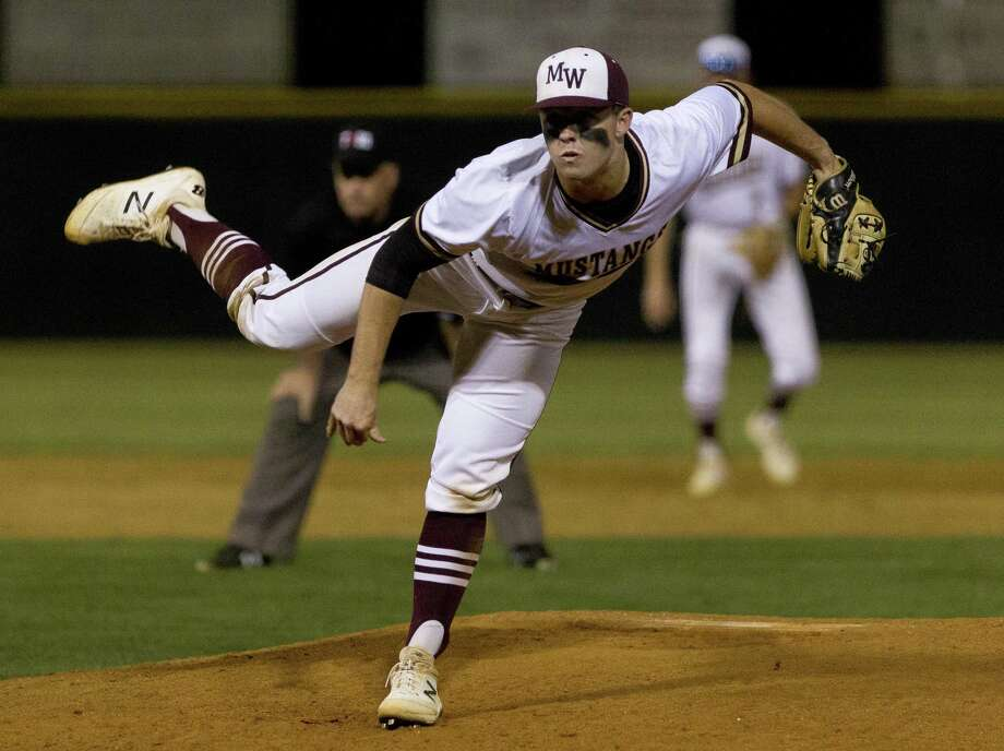 Magnolia West relief pitcher Zach Wall (8) throws during the seventh inning of a District 19-5A high school baseball game at Magnolia West High School, Tuesday, April 16, 2019, in Magnolia. Photo: Jason Fochtman, Houston Chronicle / Staff Photographer / © 2019 Houston Chronicle