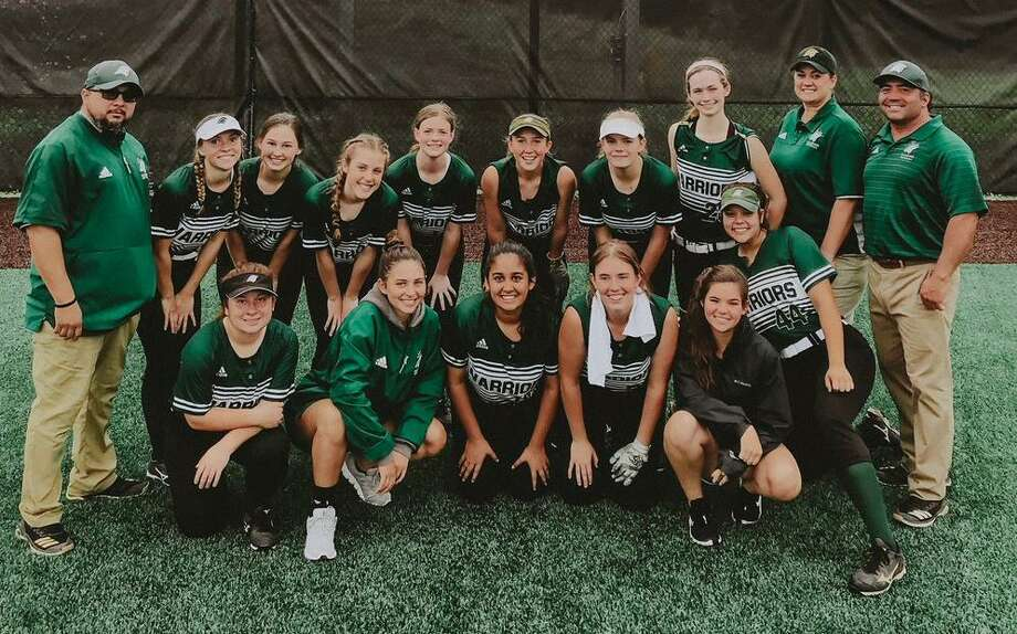 The Woodlands Christian Academy softball team celebrates its win over Bay Area Christian on Saturday, May 12, 2019 to advance to the TAPPS Division III state tournament. Photo: Photo Submitted