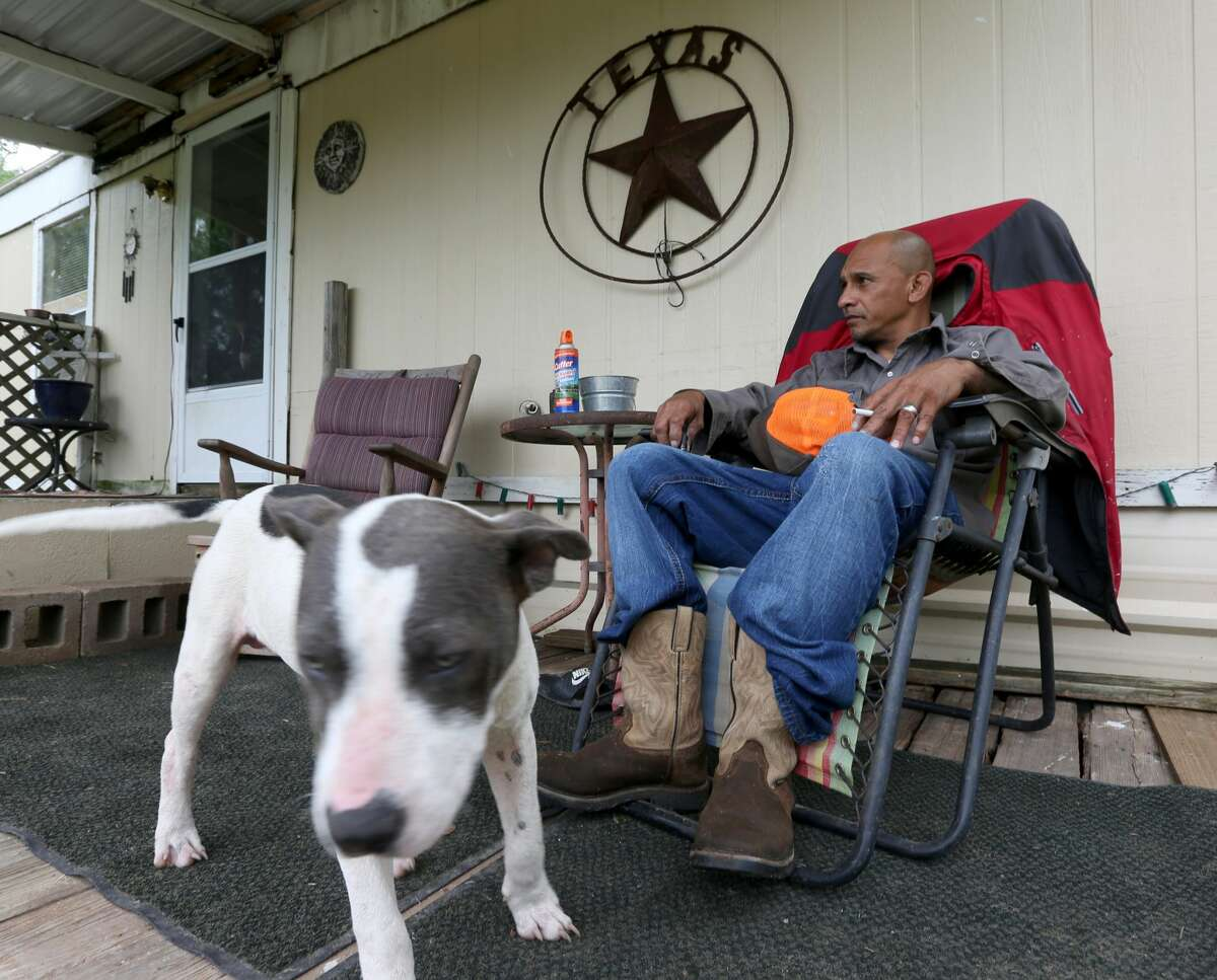 Edward Williams sits Tuesday, May 7, 2019 on his front porch in Gillett in Karnes County. Williams saw the recent multi-agency raid across the street from his home that busted a cockfighting ring.