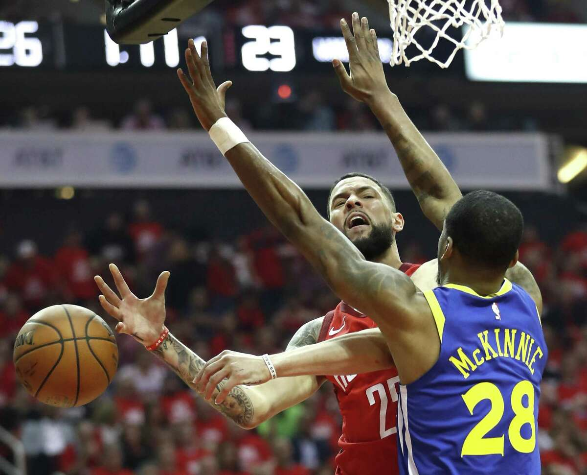 Much like the game itself, Rockets guard Austin Rivers sees the ball slip through his fingers against the Warriors' Alfonzo McKinnie during Game 6 on Friday night.