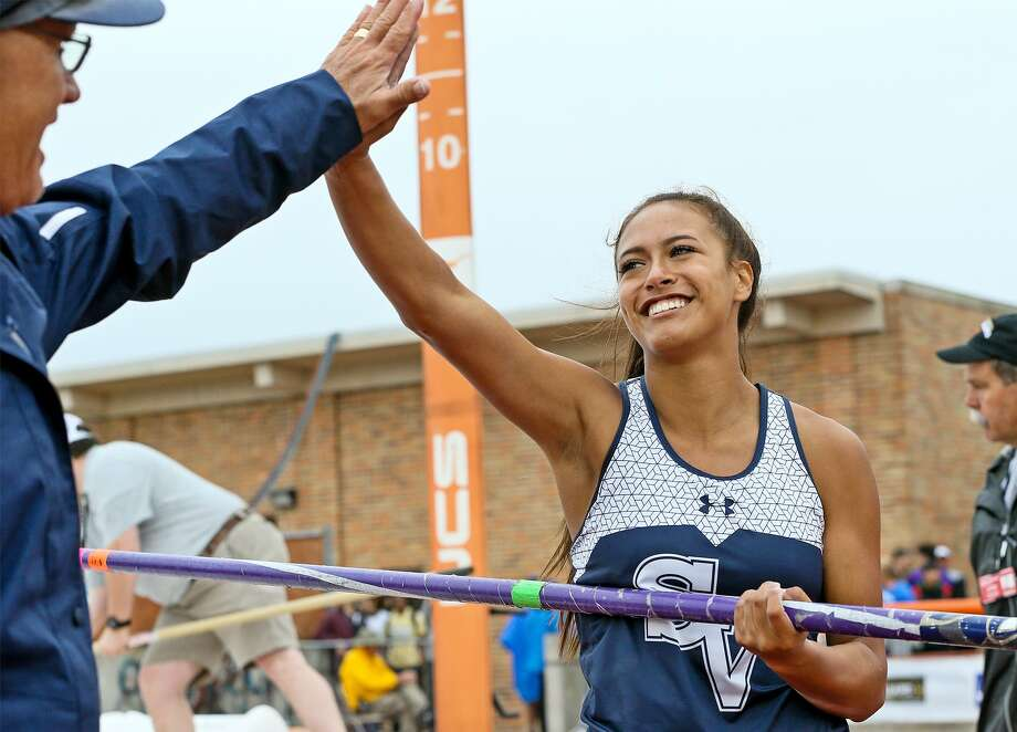 Smithson Valley's Avianna Trinidad high fives pole vault coach Doug Ulbrict after finishing second in the 6A girls pole vault during the UIL state track and field championships at Mike Myers Stadium in Austin on Saturday, May 11, 2019. Photo: Marvin Pfeiffer, Staff Photographer / Express-News 2019