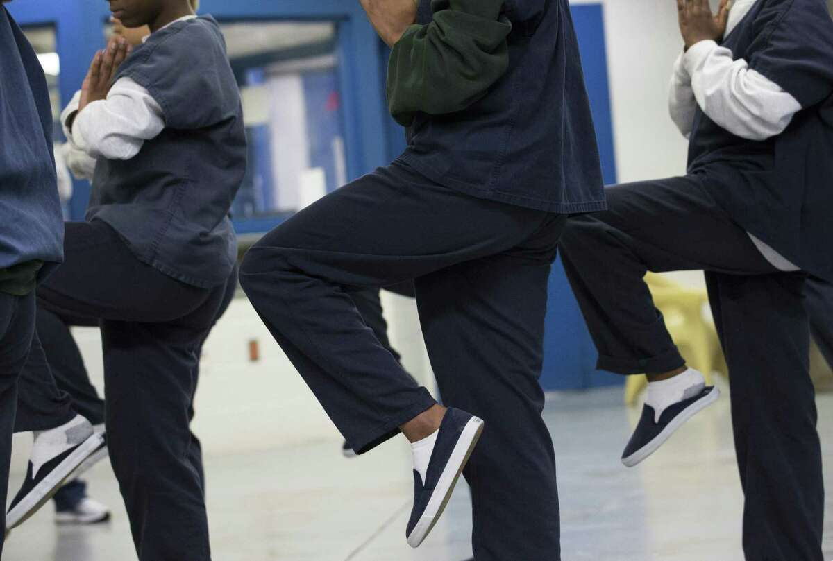 Harris County Juvenile Detention Center girls work on balancing with Houston Ballet instructors during a dance class on Friday, April 5, 2019, in Houston. The center has been increasing art and culture programs for the teenagers.