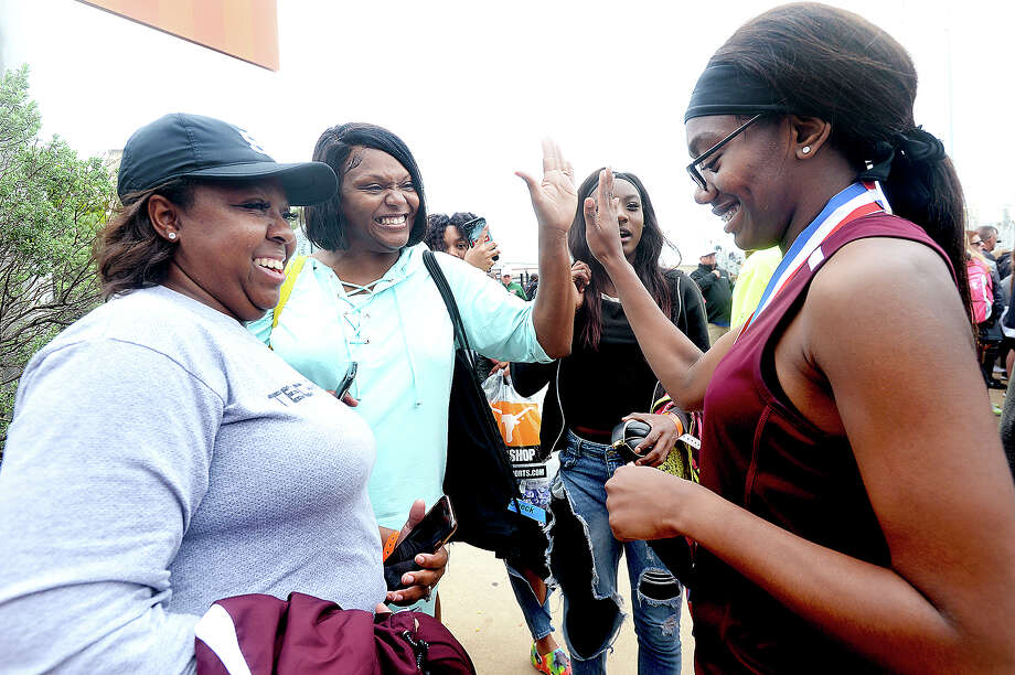 Silsbee's Honestee Holman gets congratulations from her coach Deborah Haynes (far left), mother Shinette Homan and friend Kaneisha Brydson after earning the gold medal in the 4A triple jump event during the track and field state championships in Austin.  Photo taken Saturday, May 11, 2019 Kim Brent/The Enterprise Photo: Kim Brent, The Enterprise / BEN