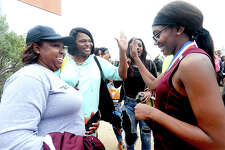 Silsbee's Honestee Holman gets congratulations from her coach Deborah Haynes (far left), mother Shinette Homan and friend Kaneisha Brydson after earning the gold medal in the 4A triple jump event during the track and field state championships in Austin. Photo taken Saturday, May 11, 2019 Kim Brent/The Enterprise