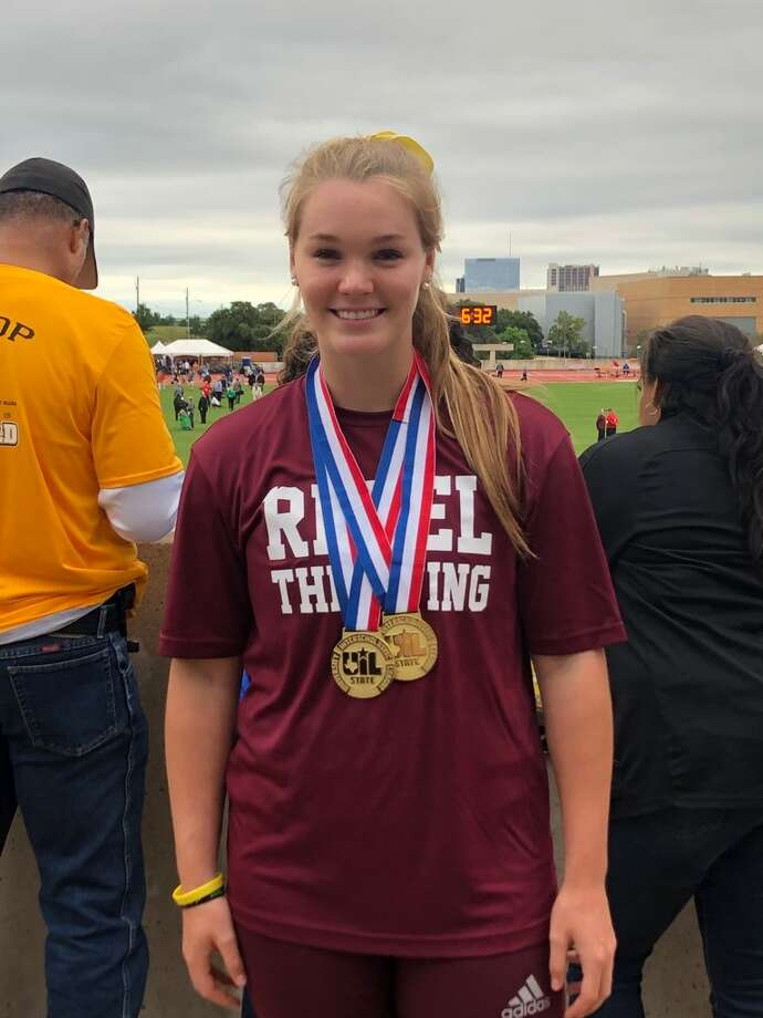 Lee's Paige Low poses with the two gold medals she won Saturday at the UIL Track & Field State Championships at Mike A. Myers Stadium in Austin. Low won gold in the Class 6A girls shot pot and the Class 6A girls discus events. Photo: Courtesy Photo