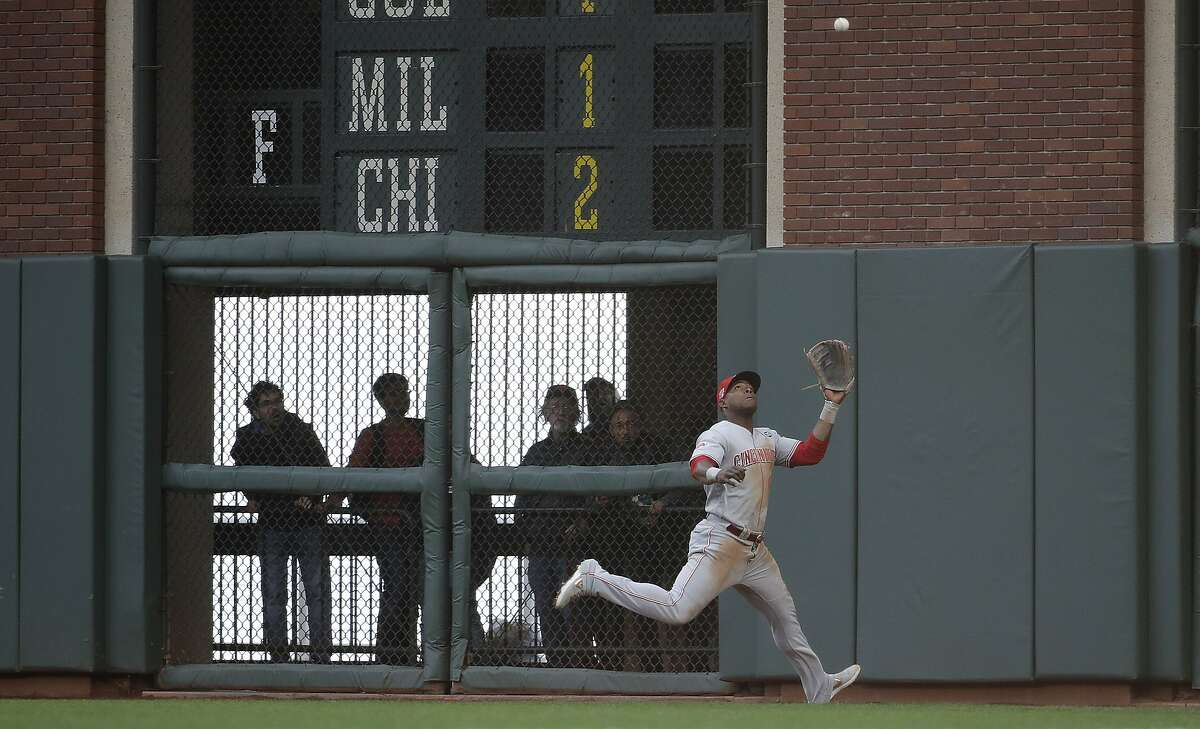Cincinnati Reds right fielder Yasiel Puig (66) runs after a San Francisco Giants' Mac Williamson fly out during the third inning of a baseball game in San Francisco, Saturday, May 11, 2019. (AP Photo/Jeff Chiu)