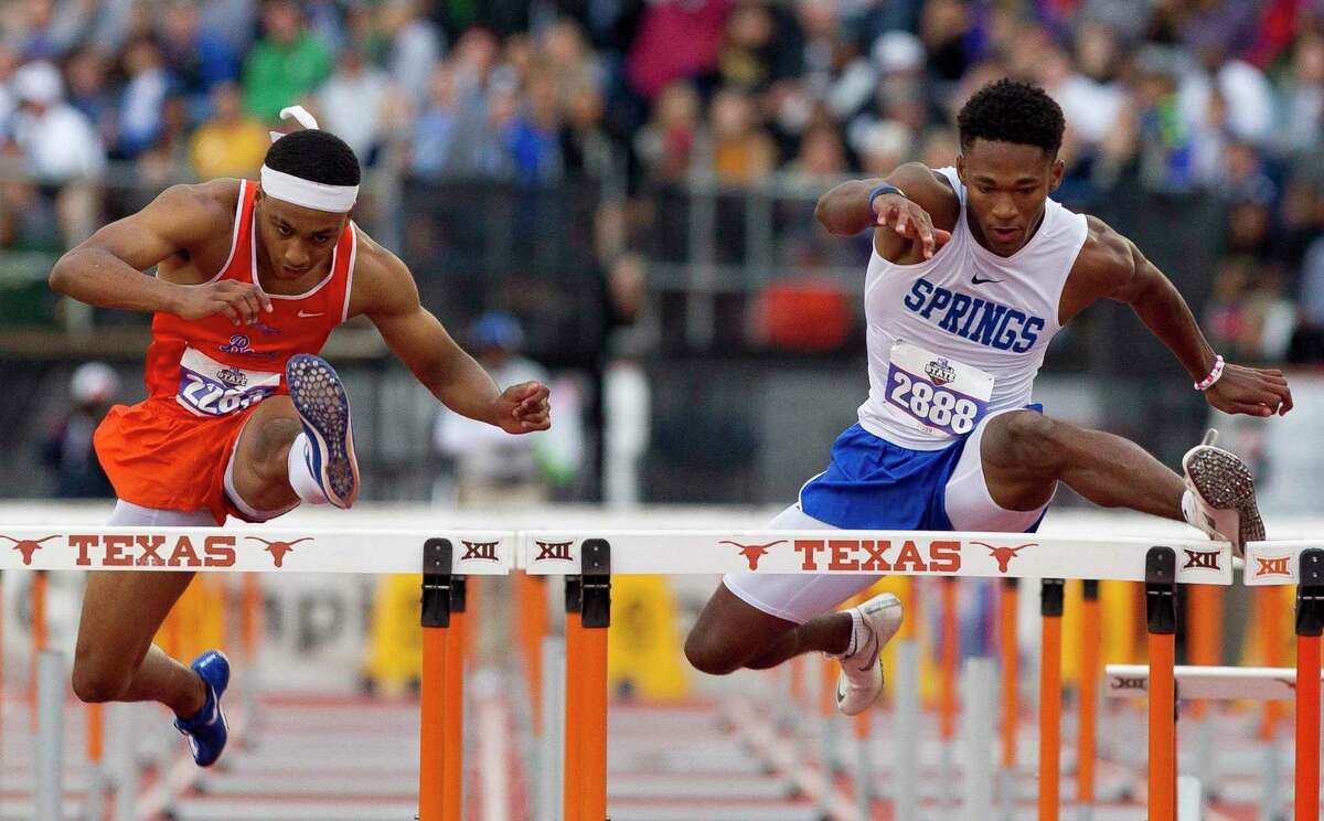 Kirk Collins (right) of Clear Springs is shown winning the Class 6A 110-meter high hurldes last spring at the state track and field meet in Austin.