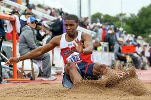 Roosevelt's Rashod Owens lands in the pit in the 6A boys long jump during the UIL state track and field championships at Mike Myers Stadium in Austin on Saturday, May 11, 2019. Owens finished sixth in the event with a jump of 23-04.