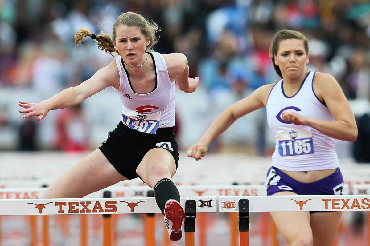 Fredericksburg's Aleah Constantime, left, clears the final hurdle in the 4A girls 100-meter hurdles during the UIL state track and field championships at Mike Myers Stadium in Austin on Saturday, May 11, 2019. Constantine finished second in the event with a time of 14.91.