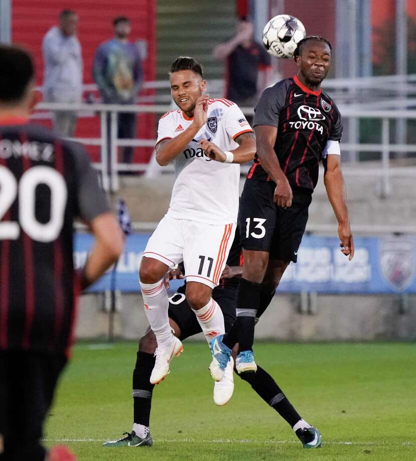 San Antonio FC's Michael Lahoud, right, goes for a header against Orange County SC's Harry Forrester. Photo: Darren Abate / Darren Abate /USL Championship / Darren Abate Media, LLC