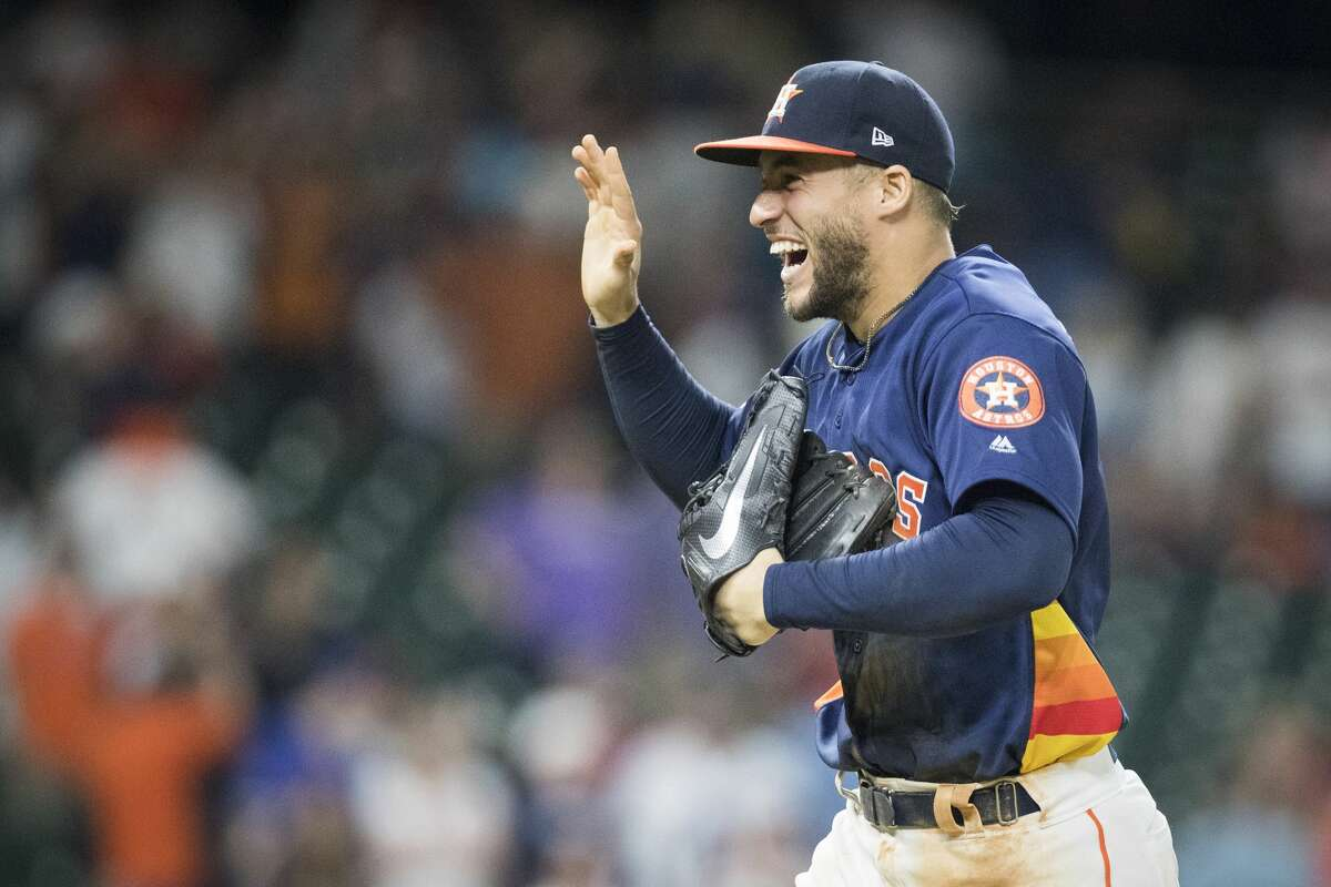 Houston Astros center fielder George Springer (4) is all smiles after the Astros won 11-4 against the Texas Rangers on Saturday, May 11, 2019, in Houston.