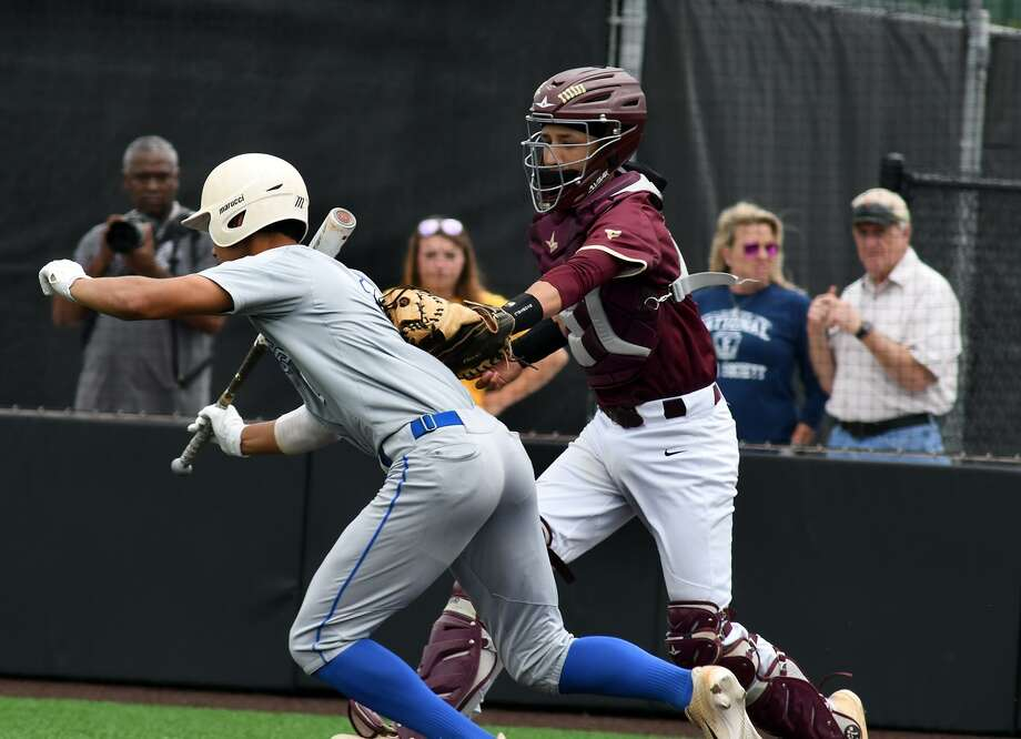 Clear Springs hitter Chase Arnaud is tagged out after a dropped third strike in the top of the fifth inning of game one of the Chargers' series with Summer Creek. Photo: Jerry Baker, Houston Chronicle / Contributor / Houston Chronicle