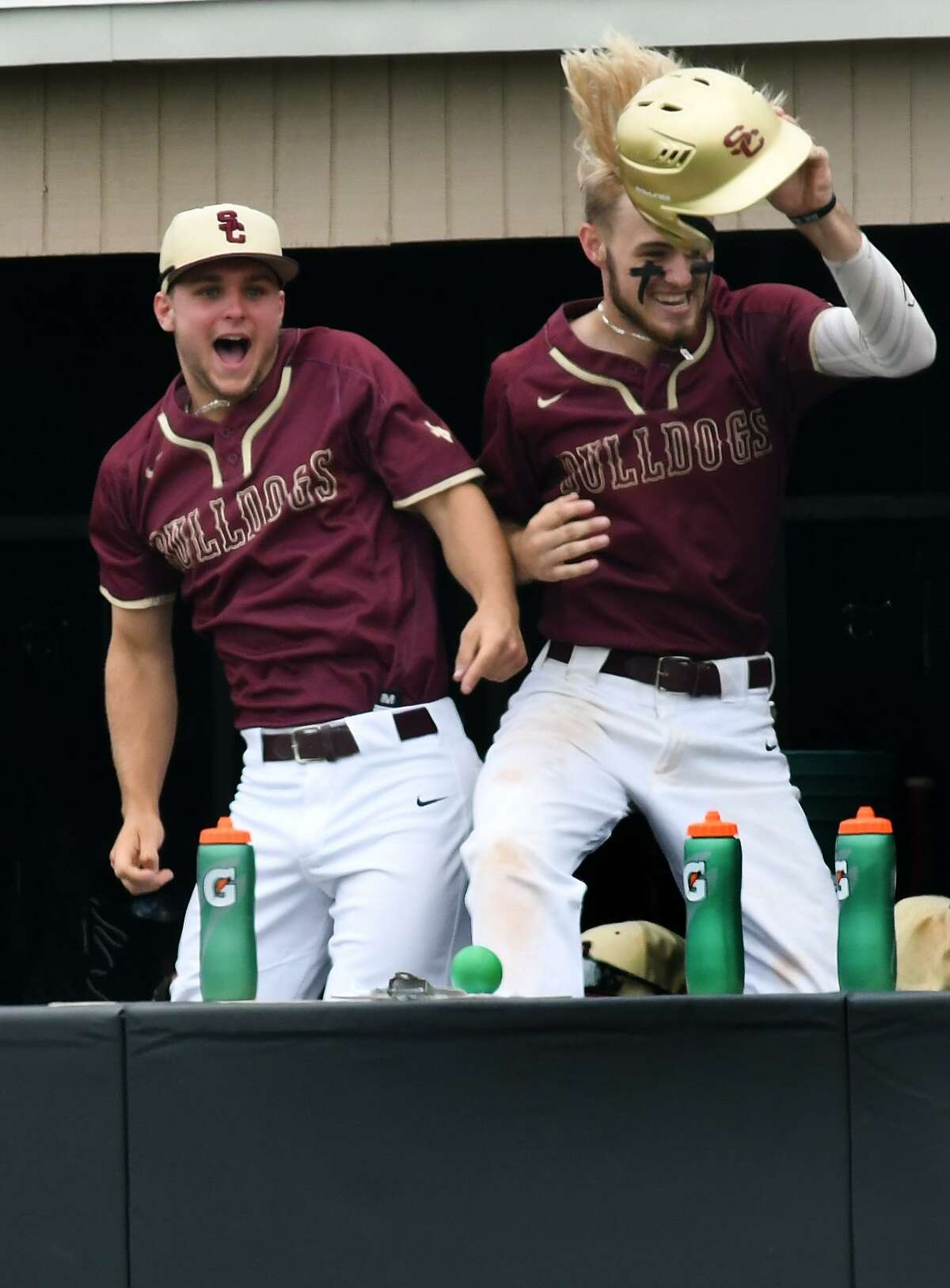 Summer Creek's Tyler Via, right, celebrates his run scored in the bottom of the 4th inning with teammate Landon Newcomb against Clear Springs during Game One of their Region II-6A Area Baseball Playoff series at Humble High School on May 10, 2019.