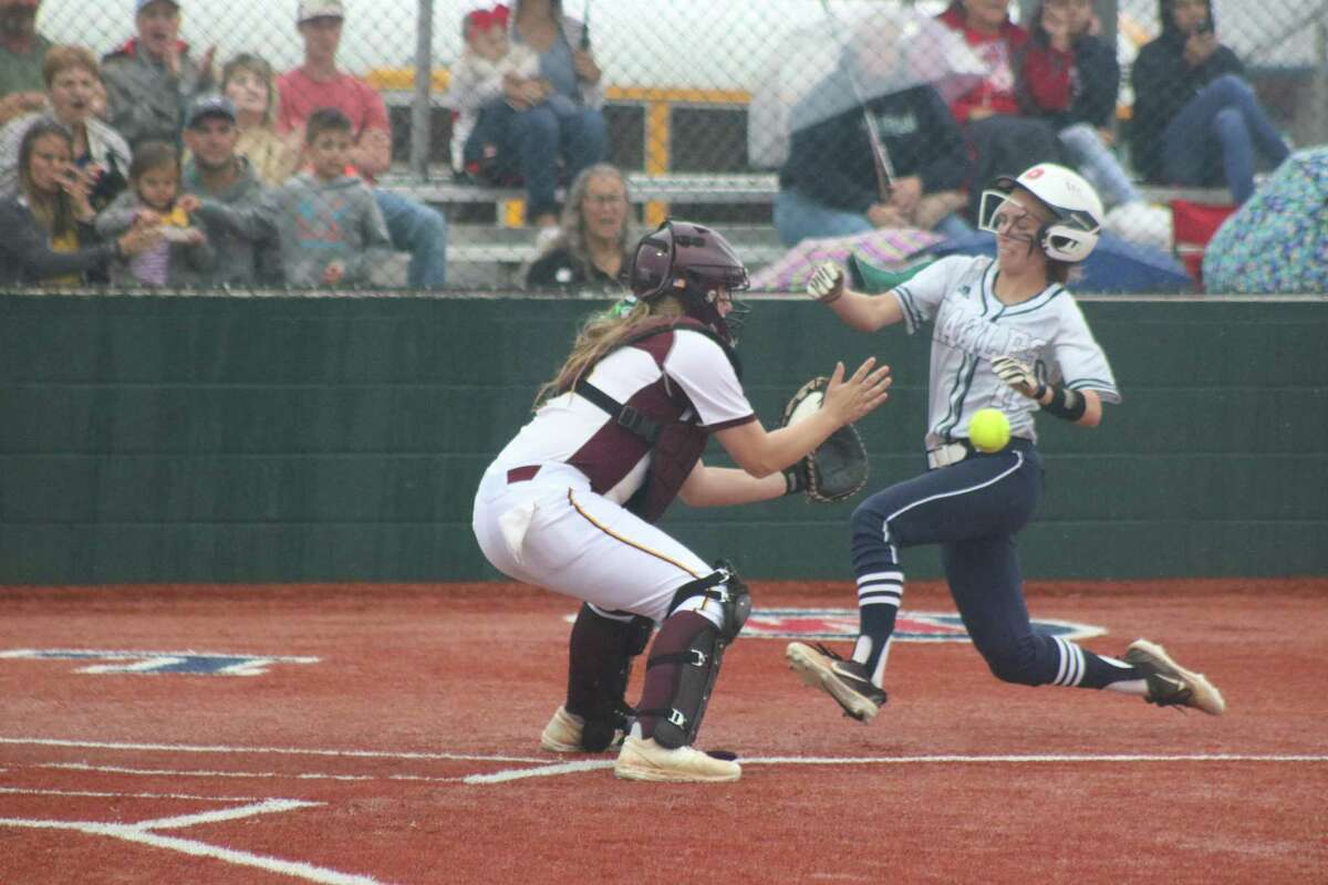 Deer Park catcher Kaurie Winters prepares to grab the throw as Pearland Dawson runner Kirsten Williams begins her slide during second-inning action Saturday night. Winters applied the tag.