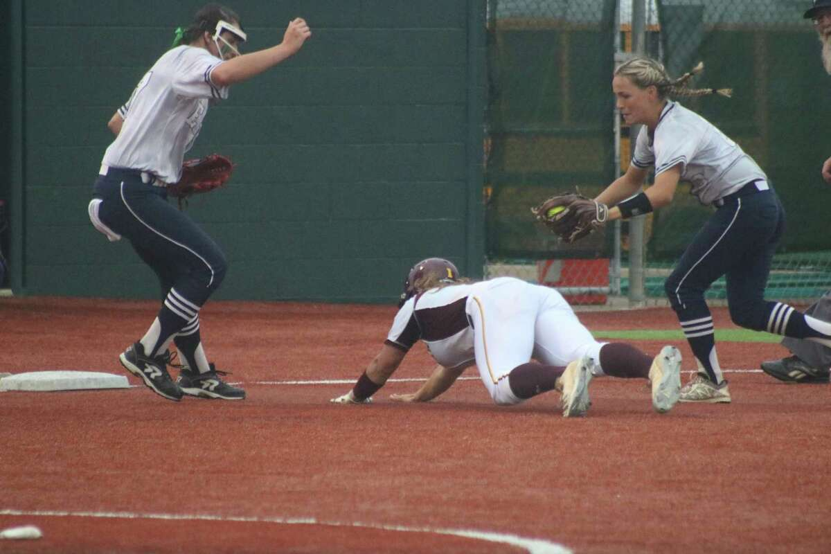 Deer Park's Sara Vanderford dives for the third-base bag after coming up with a three-RBI hit that got her teammates within 7-6 Saturday night.