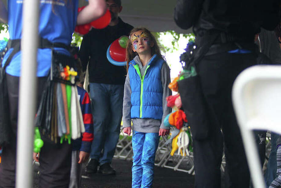 Eleanor Mack, 7, of Jacksonville watches balloon animals being made at the Osage Orange Festival Saturday at Illinois College. For more photos from the event, find the slideshow online at www.myjournalcourier.com. Photo: Rosalind Essig | Journal-Courier