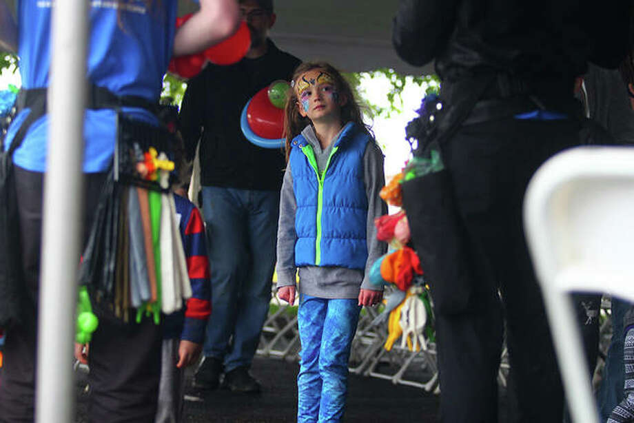 The Illinois College Osage Orange Festival drew all ages Saturday despite the chilly weather. The event had games, food and live music. Photo: Rosalind Essig | Journal-Courier
