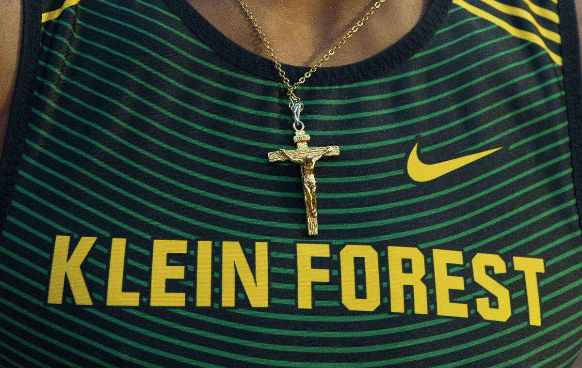 Auhmad Robinson of Klein Forest wears a necklace of Jesus on the cross after finishing second in the 6A boys 800-meter relay during the UIL State Track & Field Championships at Mike A. Myers Stadium, Saturday, May, 11, 2019, in Austin.