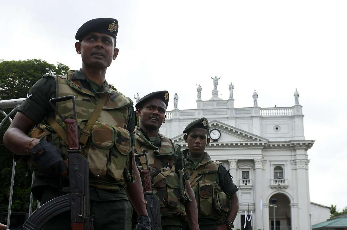 Sri Lankan Army soldiers stand guard at the St Lucia's Cathedral during a holly mass held to bless the victims of Easter Sunday attacks in Colombo on May 11, 2019. - A total of 257 people were killed and nearly 500 wounded. At least 44 foreigners were among the dead. Nearly 50 of the victims were young children. (Photo by LAKRUWAN WANNIARACHCHI / AFP)LAKRUWAN WANNIARACHCHI/AFP/Getty Images