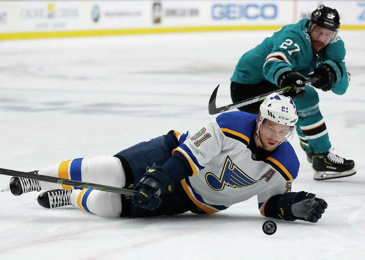 The Blues' Vladimir Tarasenko (front) is down on the ice battling for the puck against the Sharks' Joonas Donskoi in the Game 1 of the Stanley Cup Western Conference finals on Saturday night in San Jose, Calif.