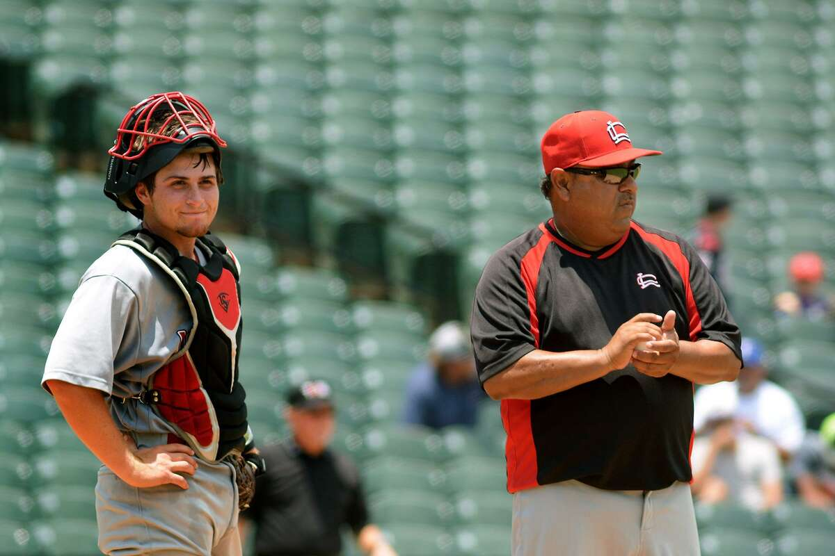 Former Langham Creek catcher Mikey Hoehner, left, waits on the mound with Lobos head coach Armando Sedeño during a pitching change in the bottom of the 6th inning against Dallas Jesuit in their 2016 UIL Baseball State Championships semifinal matchup at Dell Diamond in Round Rock on Friday, June 10, 2016.