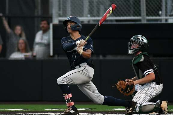 Kingwood pitcher Masyn Winn, left, and Clear Falls senior catcher Brooks Montgomery follow Winn's homerun to leftfield in the bottom of the third inning of Game One of their best of three series at Humble High School on May 10, 2019. (Photo by Jerry Baker)