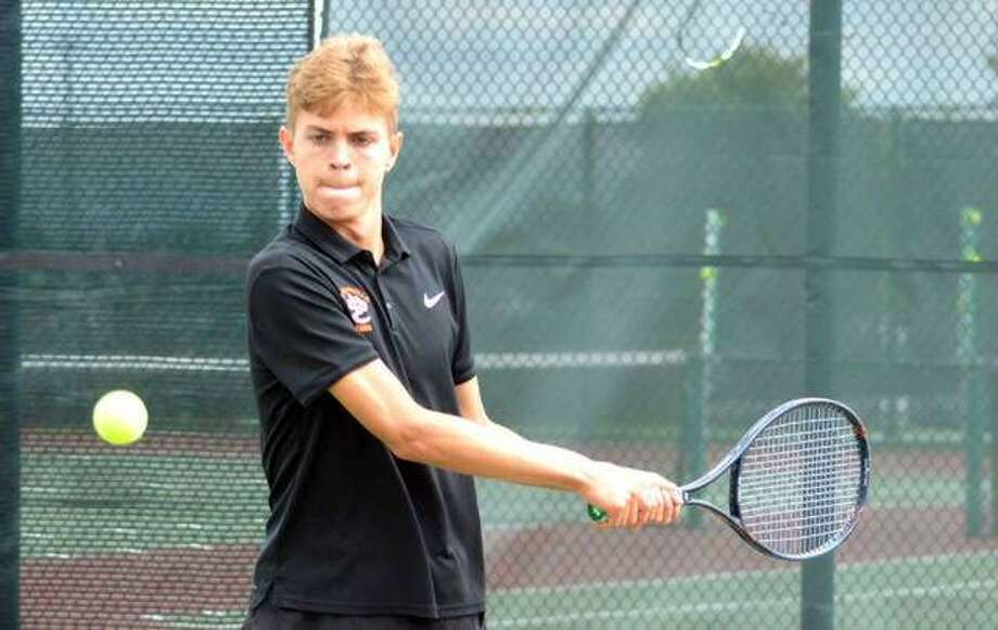 Edwardsville sophomore Ben Blake returns a shot during his No. 3 doubles match in the Southwestern Conference Tournament on Friday at Belleville West.