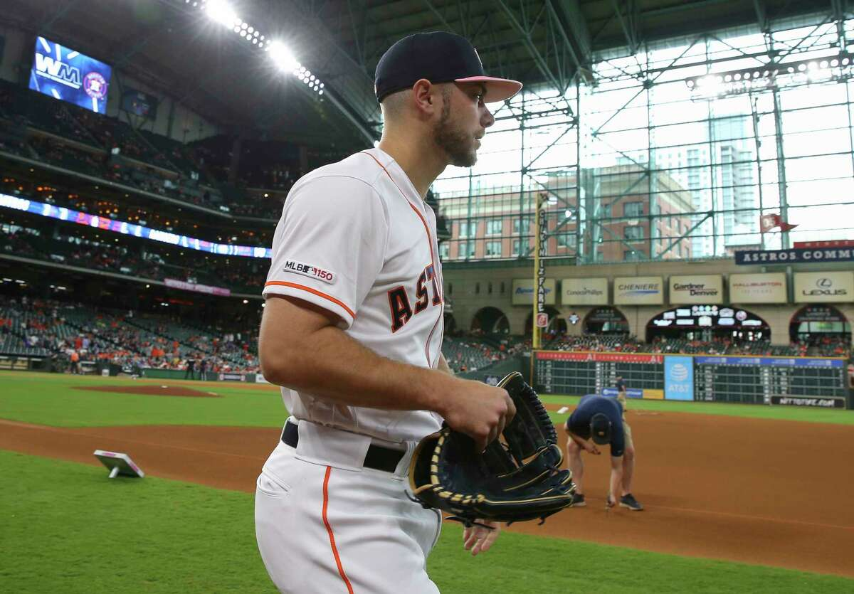Houston Astros starting pitcher Corbin Martin (29) makes his way to the bullpen to warm up before the game against the Texas Rangers at Minute Maid Park on Sunday, May 12, 2019, in Houston.