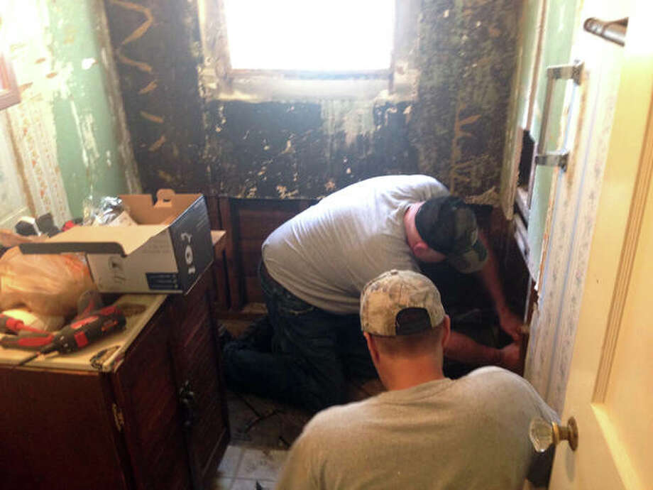 Professional volunteers help to remodel a bathroom for a 97-year old World War II veteran who lives in Alton. The project was paid for by Veterans Caring for Veterans.