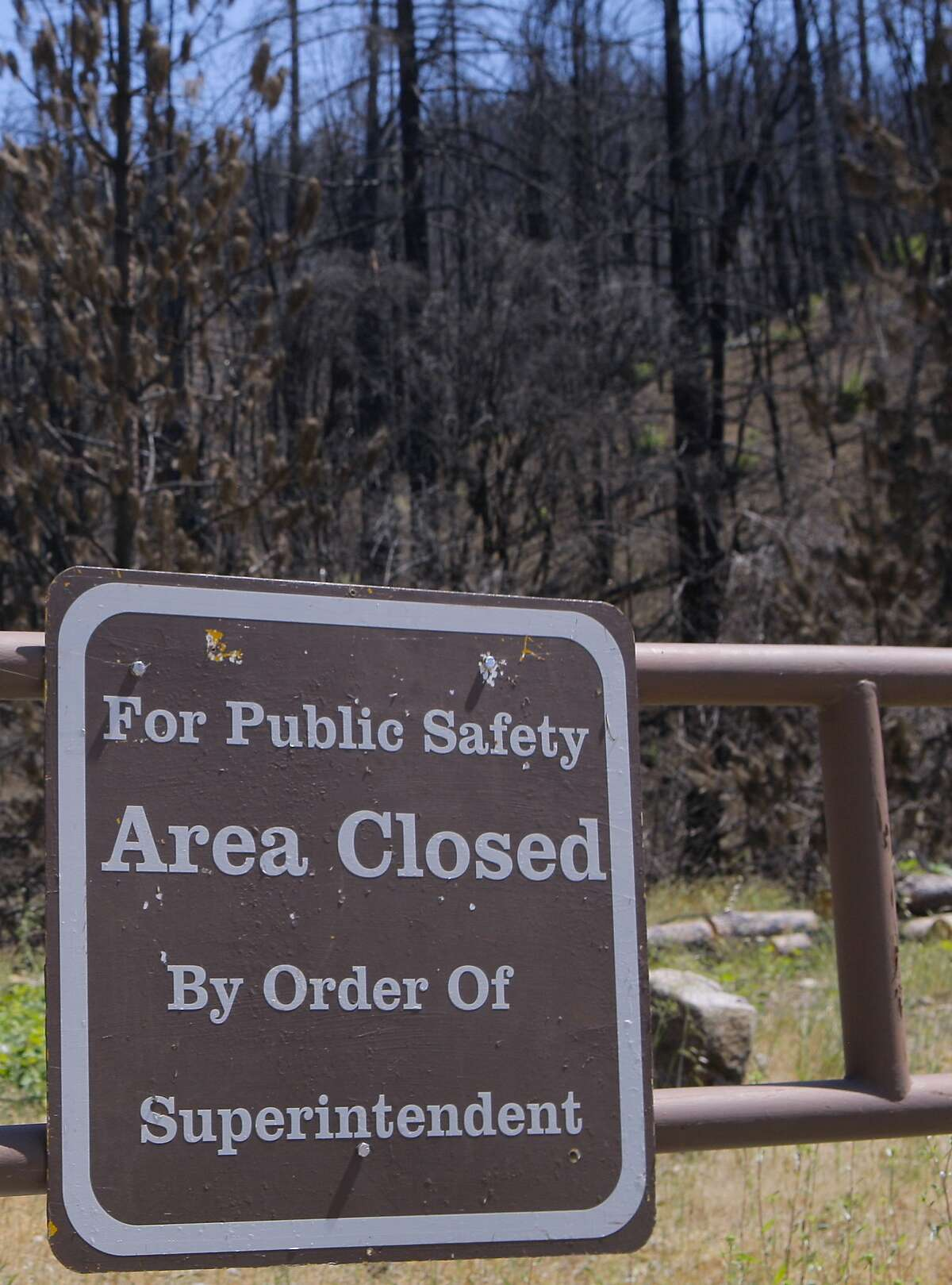 A locked gate bars visitors from an area burned by the Carr Fire at Whiskeytown National Recreation Area