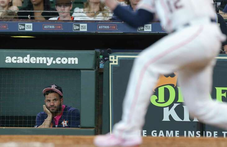 Houston Astros second baseman Jose Altuve watches tammate Max Stassi swinging during the bottom second inning against the Texas Rangers at Minute Maid Park on Sunday, May 12, 2019, in Houston. Altuve was placed on the 10-day injured list with a strained left hamstring on Saturday, fallout from his first-inning exit during Friday's game.