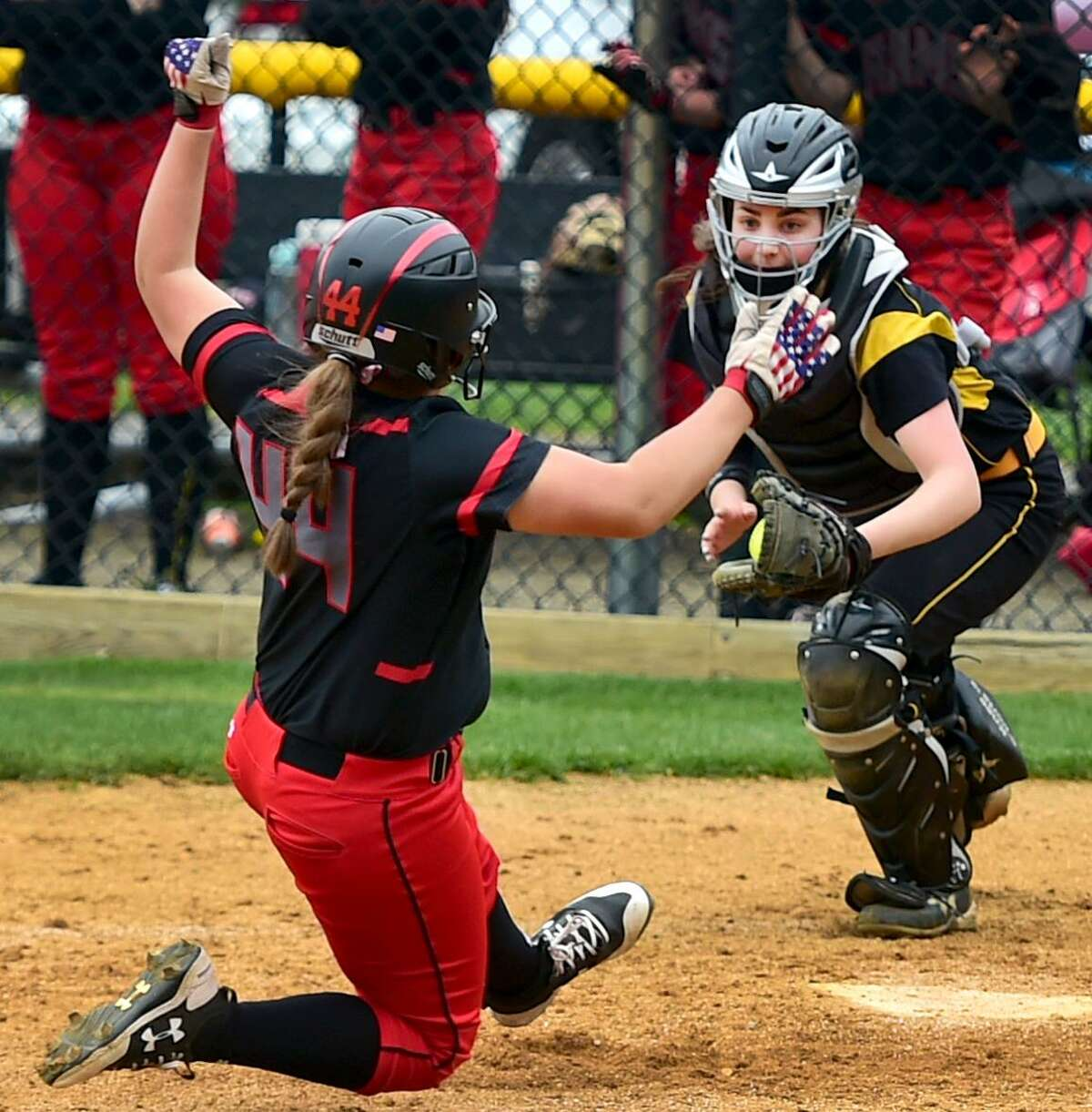 Catcher Rachel Crow, right, and the Amity softball team have won seven of their last eight games.