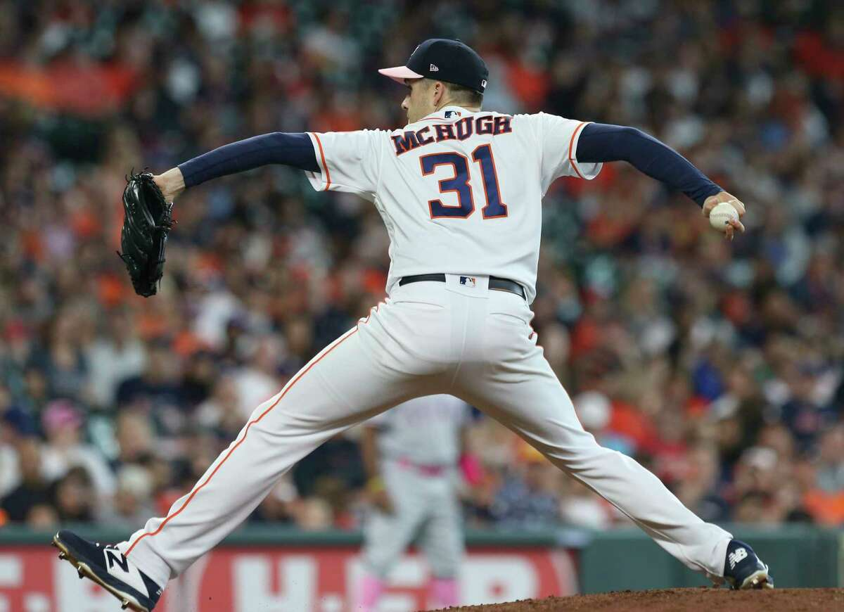 Houston Astros relief pitcher Collin McHugh (31) pitches during the top sixth inning against the Texas Rangers at Minute Maid Park on Sunday, May 12, 2019, in Houston.