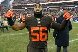 CLEVELAND, OH - DECEMBER 23, 2018: Linebacker Xavier Woodson-Luster #56 of the Cleveland Browns walks off the field after a game against the Cincinnati Bengals on December 23, 2018 at FirstEnergy Stadium in Cleveland, Ohio. Cleveland won 26-18. (Photo by: 2018 Nick Cammett/Diamond Images/Getty Images)