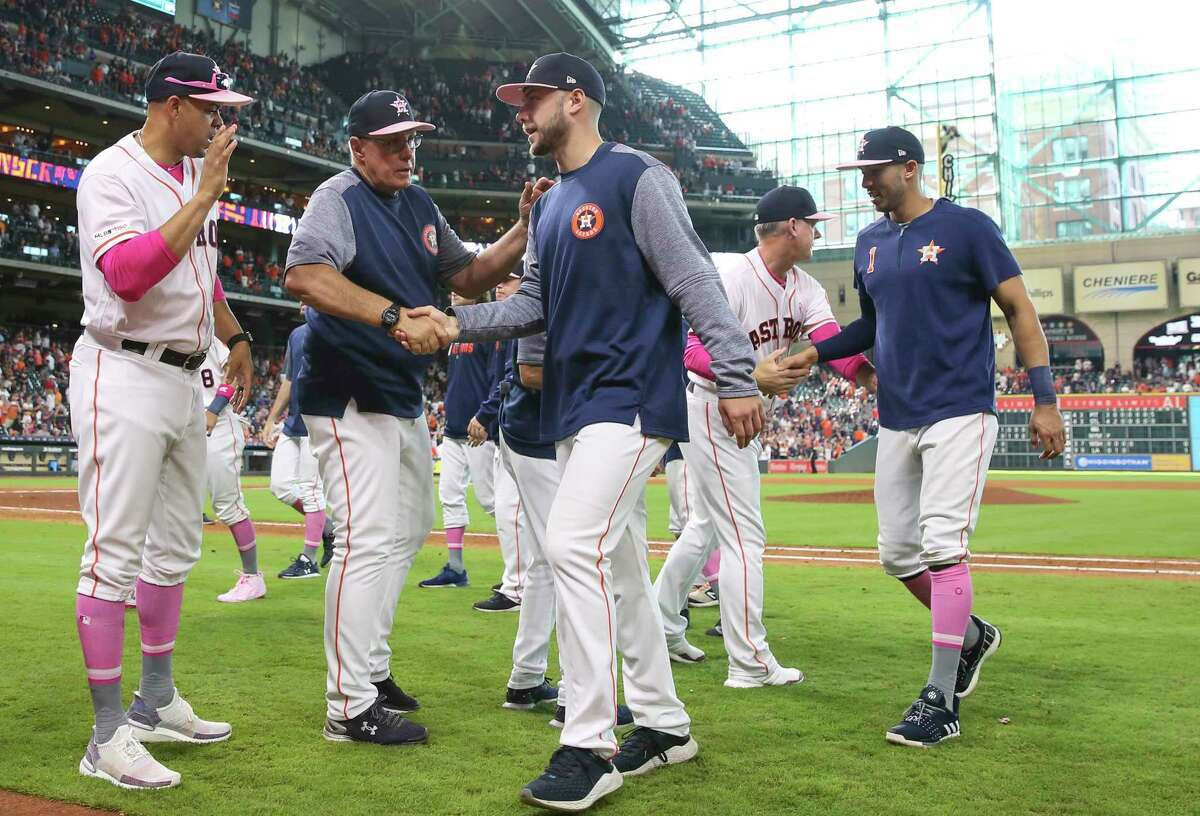 Houston Astros starting pitcher Corbin Martin shakes hands with pitching coach Brent Strom after his debut and the Astros defeated the Texas Rangers 15-5 at Minute Maid Park on Sunday, May 12, 2019, in Houston.