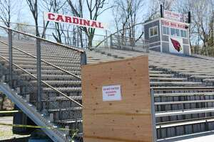 The Cardinal Stadium home bleachers are closed during the boy's lacrosse game at Greenwich High School in Greenwich, Conn. Thursday, April 16, 2019. The school board will examine options for a renovated stadium, including new bleachers, Thursday.