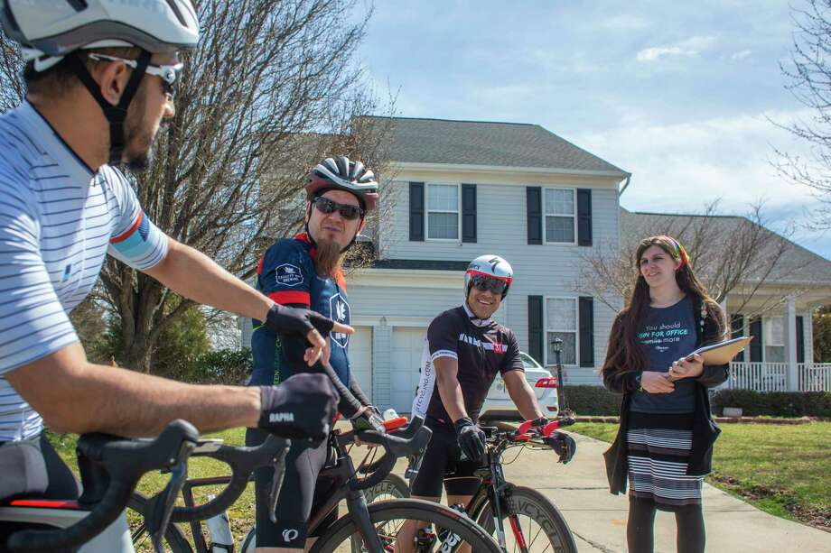 From left, Tommy Yap, Dave Evans and Augusto Gomez talk with Virginia Del. Danica Roem, D-Prince William, in Manassas. She is up for re-election in the fall. Photo: Photo For The Washington Post By Cal Cary / Cal Cary