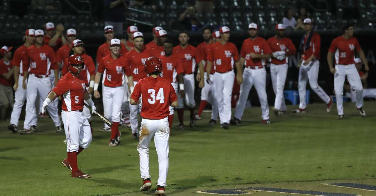 University of Houston Kyle Lovelace (34) celebrates his run scored on Jared Triolo's two-run double in the eighth inning of an NCAA basball game at Reckling Park, Wednesday, May 1, 2019, in Houston .