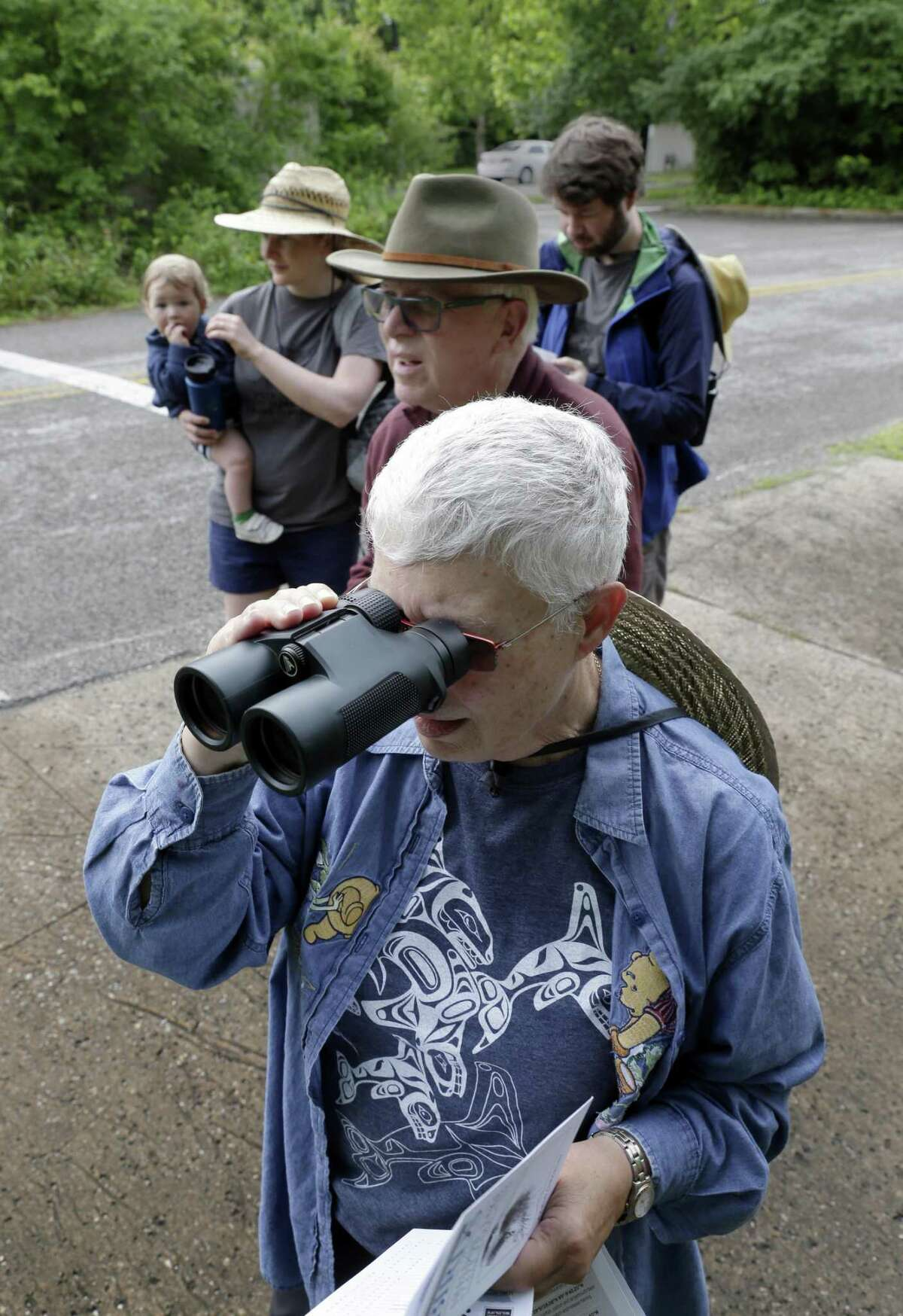 (From left) Isaac Touzel, age 11 mos., held by his mother Marla Touzel, Marion Touzel, Tim Touzel and Joseph Touzel begin looking for birds as they compete in The Great Texas Birding Classic at Sheldon Lake State Park Sunday, May. 12, 2019 in northeast Houston, TX.