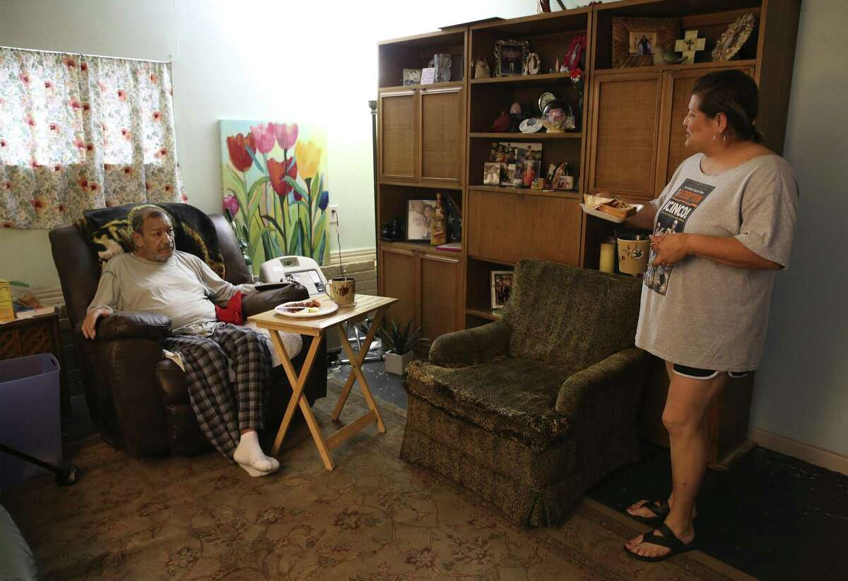 Susan Martinez (right) brings breakfast for her husband, Alex Silva, on Thursday, May 2, 2019. Martinez currently does not have health insurance and Silva is on hospice care through Medicare, according to Martinez. New data released this week by the Health Care Cost Institute shows that the same services could cost up to 39 times more, even within the same metro area. In the San Antonio-New Braunfels metro area, the price of a standard blood test, coded as a comprehensive metabolic panel, ranges between $56 to $492. Martinez, 56, who has cut hair for more than 20 years, struggles to pay for medical bills and because of a billing mixup she lost her insurance coverage. She found out she had walking pneumonia last week. She is also caring for her husband while he is on at-home long-term hospice care because of advanced kidney failure. (Kin Man Hui/San Antonio Express-News)