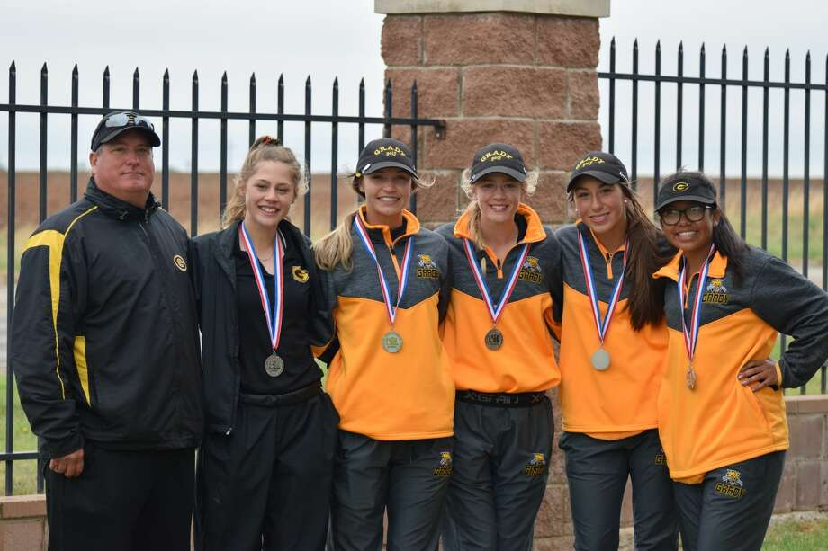 The Grady girls golf team, from left to right, coach Chris Short, Grace Williams, Raina Short, Kardian Williams, Sydney Gonzales, and Zoey Ruiz pose after the Region I-1A golf tournament at the Reece Golf Center in Lubbock on April 23. Photo: Courtesy Photo