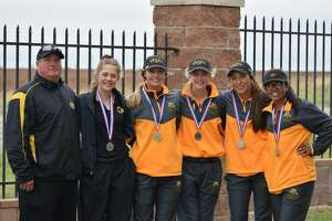 The Grady girls golf team, from left to right, coach Chris Short, Grace Williams, Raina Short, Kardian Williams, Sydney Gonzales, and Zoey Ruiz pose after the Region I-1A golf tournament at the Reece Golf Center in Lubbock on April 23.