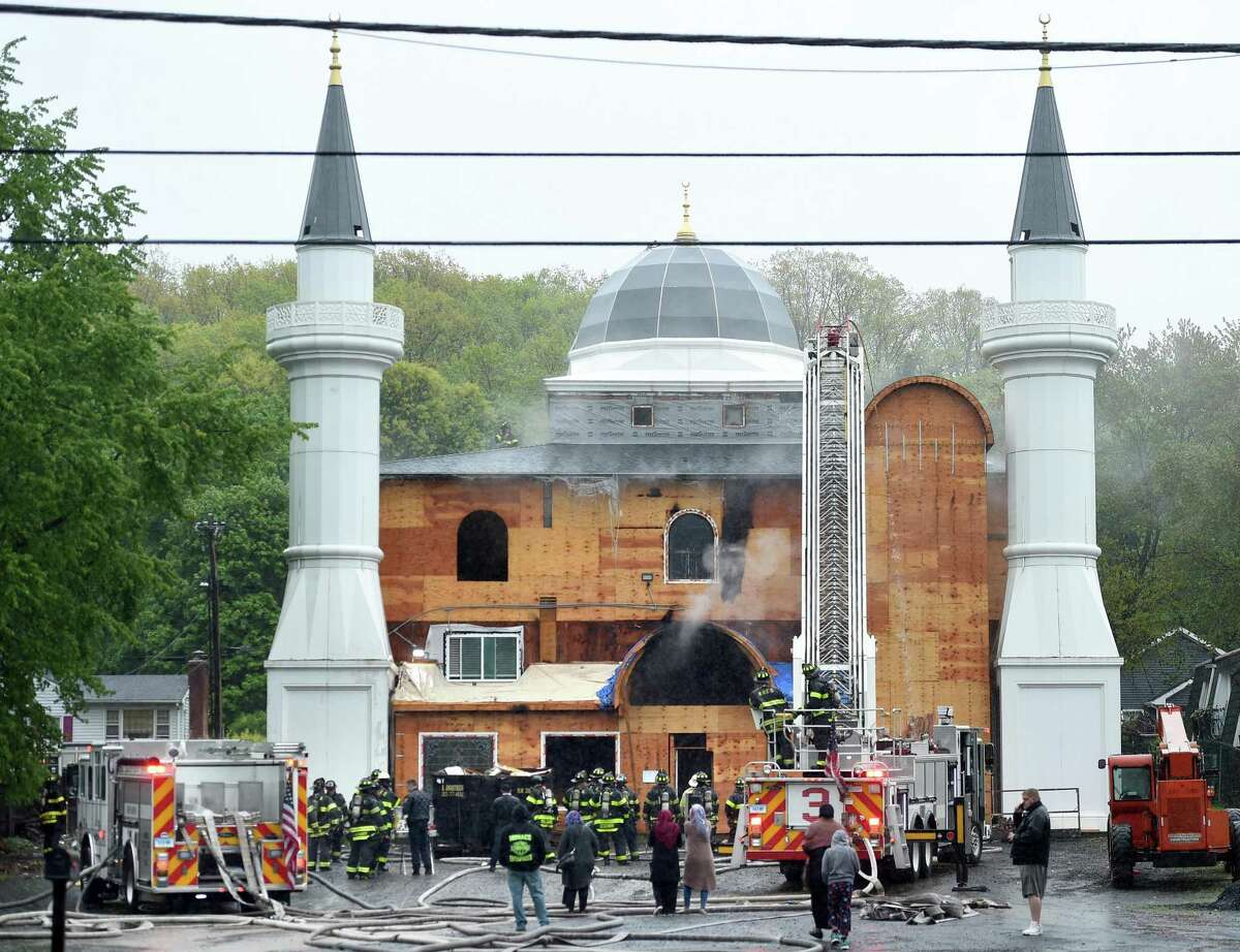 New Haven firefighters respond to a fire at the Diyanet Mosque of New Haven on Middletown Avenue on May 12, 2019.