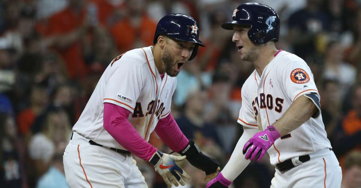 Houston Astros third baseman Alex Bregman (2) celebrates his three-run home run with George Springer (4) during the bottom fifth inning at Minute Maid Park on Sunday, May 12, 2019, in Houston.