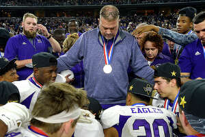 Newton's head coach W.T. Johnston gathers with his team after defeating Canadian for a state title in the Class 3A Div. II game at AT&T Stadium. Photo taken Thursday, December 20, 2018 Kim Brent/The Enterprise