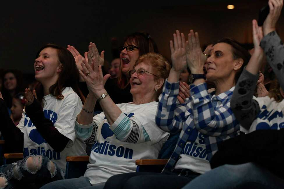 Taylor VanDenburg, sister of American Idol local sensation Madison VanDenburg, her grandmother Norrine VanDenburg, and sister Darcy VanDenburg cheer on the 17-year-old following her second song of the American Idol episode during a viewing party at Shaker High School on Sunday, May 12, 2019 in Latham, N.Y. (Jenn March, Special to the Times Union)