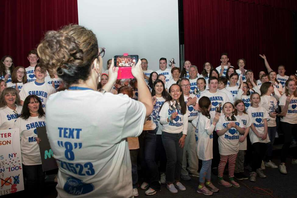 Deputy Superintendent of Shaker school district Kathy Skeals takes a video of Madison VanDenburg supporters during an American Idol viewing party at Shaker High School on Sunday, May 12, 2019 in Latham, N.Y. (Jenn March, Special to the Times Union)