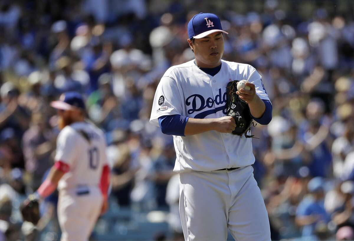 Los Angeles Dodgers starting pitcher Hyun-Jin Ryu pauses on the mound after giving up a double to Washington Nationals Gerardo Parra during the eighth inning of a baseball game Sunday, May 12, 2019, in Los Angeles. (AP Photo/Marcio Jose Sanchez)