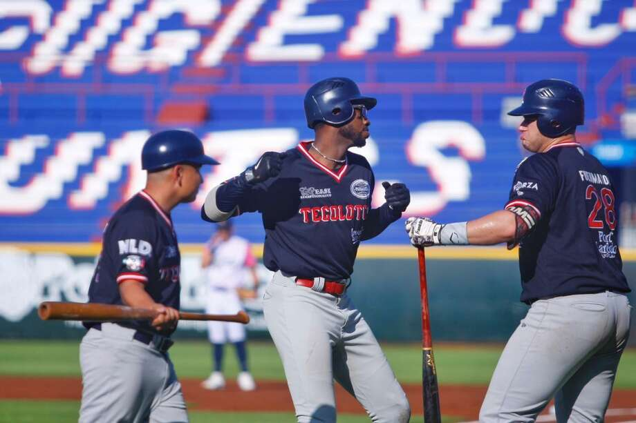 Domonic Brown, left, hit a pair of solo home runs Sunday in the Tecolotes' 7-4 victory at Quintana Roo. Photo: Courtesy Of The Tecolotes Dos Laredos