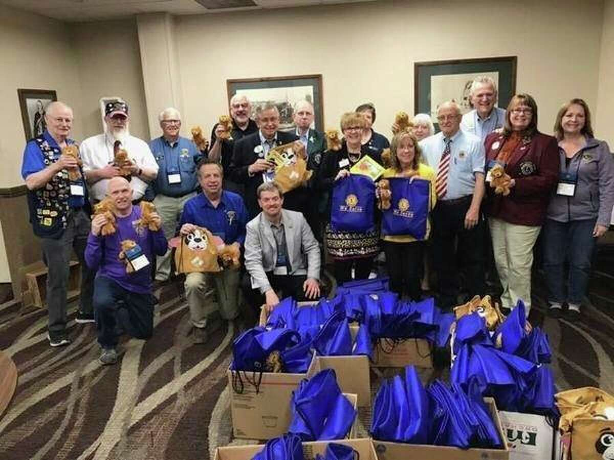 Lions Club members display hospital bags for children. (Photo provided)